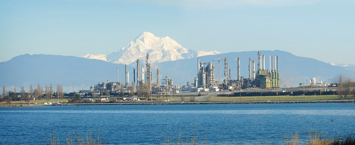 Anacaortes Refinery in Washington State from across the water with a mountain in the background