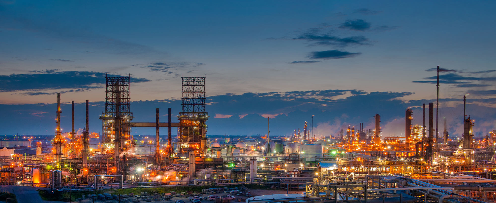 Panoramic side view of refinery at dusk